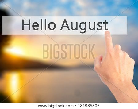 Hello August - Hand Pressing A Button On Blurred Background Concept On Visual Screen.