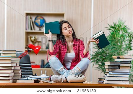 Young female student preparing for college school exams