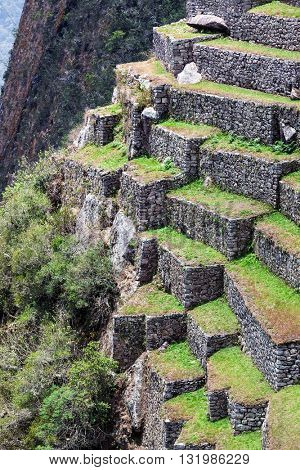 ruins of old terraces on the mountain to Machu Picchu