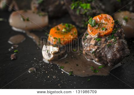 Beef bourguignon and sauce on the black stone horizontal