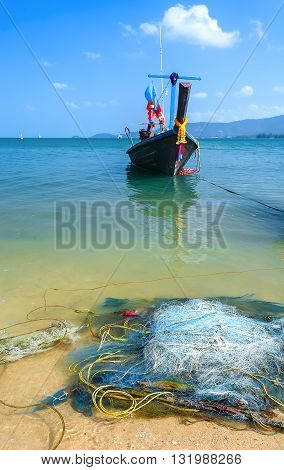 The fishing nets. Wooden fishing boat the turquoise sea.