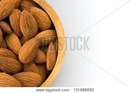 bowl wood of almonds isolated on white background