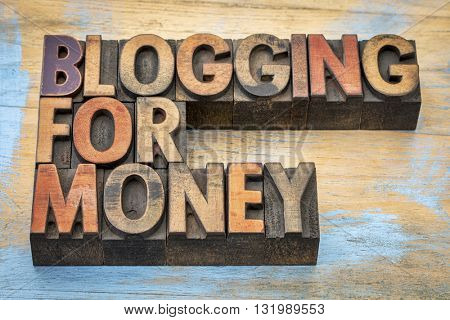 blogging for money - internet and entrepreneur concept - text in vintage letterpress wood type stained by color inks