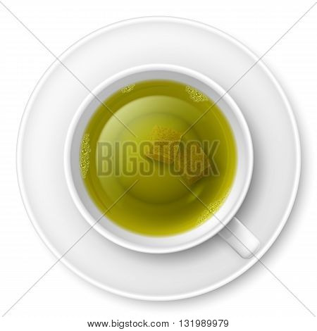 Cup of green tea with brown lump sugar