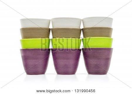 colorful decorative flower pots on white background
