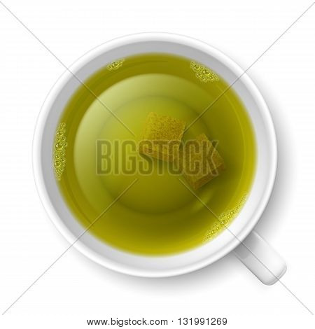 Cup of green tea with lumps of yellow cane sugar over white background