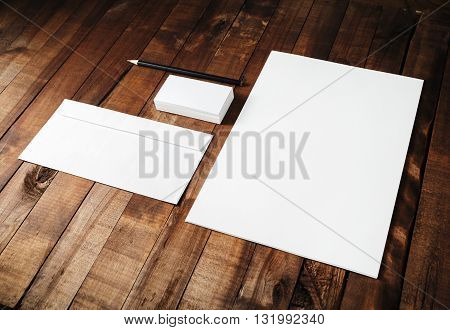 Blank branding ID template on vintage wooden table background. Mock-up for design portfolios.