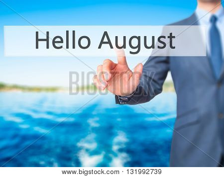 Hello August - Businessman Hand Pressing Button On Touch Screen Interface.