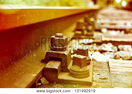 old railway track in the sunlight with selective focus