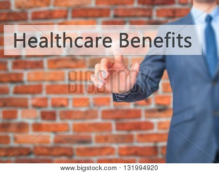 Healthcare Benefits - Businessman Hand Pressing Button On Touch Screen Interface.