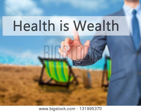 Health Is Wealth - Businessman Hand Pressing Button On Touch Screen Interface.