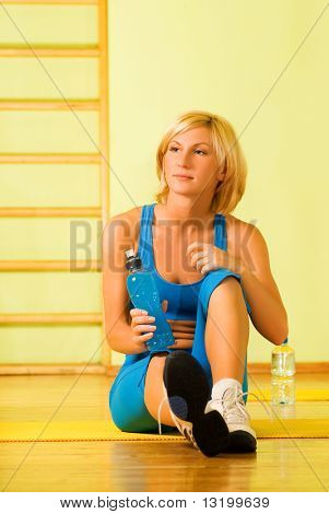 Beautiful woman relaxing after fitness exercise