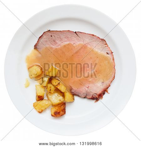 Roasted veal fillet with fried potatoes, isolated on white