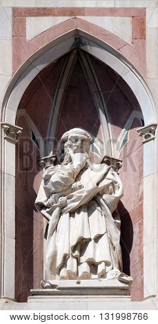 FLORENCE, ITALY - JUNE 05: Il Pensatore(The Thinker) by Donatello, Campanile(Bell Tower) of Cattedrale di Santa Maria del Fiore(Cathedral of Saint Mary of the Flower), Florence, Italy on June 05, 2015