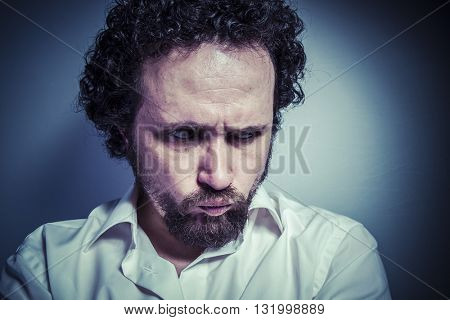 sad face, man with intense expression, white shirt