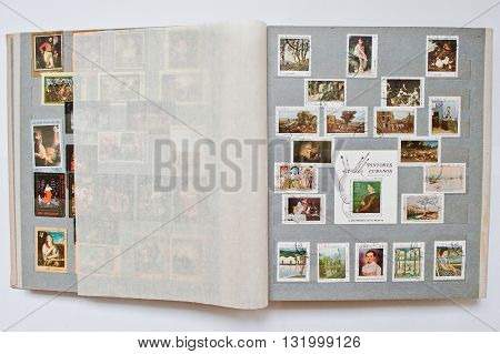 Uzhgorod, Ukraine - Circa April, 2016: Collection Of Postage Stamps In Album From Cuba Shows The Dif