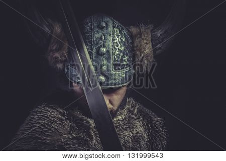 Conflict, Viking warrior with a huge sword and helmet with horns