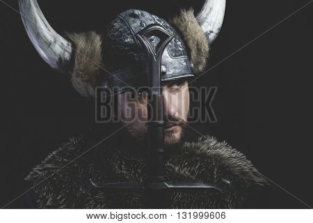 Leadership, Viking warrior with iron sword and helmet with horns