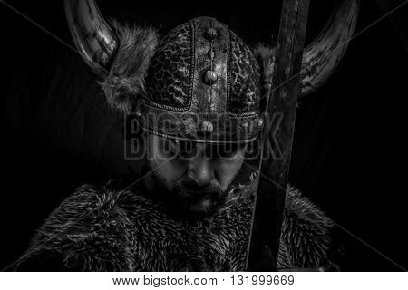Traditional, Viking warrior with iron sword and helmet with horns