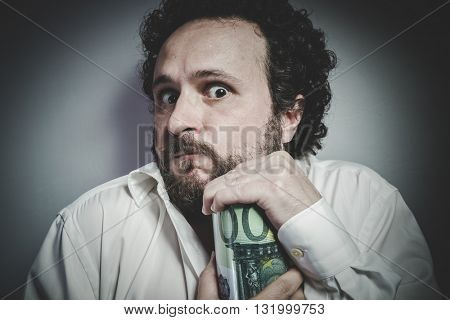 Saver, man with intense expression, white shirt