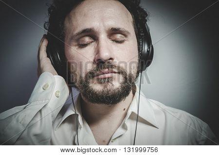 enjoy the music, man with intense expression, white shirt