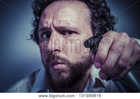 cleaning spray, man with intense expression, white shirt