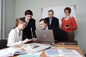 picture of people work  - Group of 5 business people working together in the office - JPG