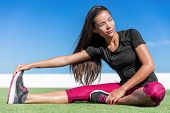 Постер, плакат: Fitness woman stretching one leg toe touch stretch exercising hamstring and glute muscles stretches
