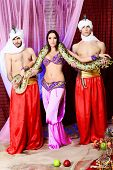 image of concubine  - Shot of young people in oriental costumes posing with a python - JPG