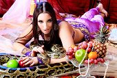 image of concubine  - Shot of an oriental woman posing with a python - JPG