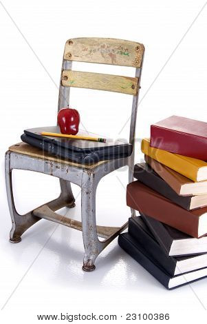 Old School Chair, Laptop And Stack Of Books