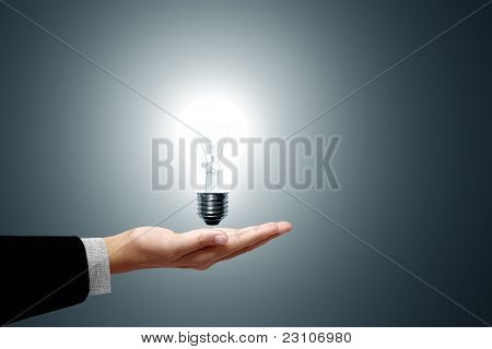 Light bulb in hand businessman