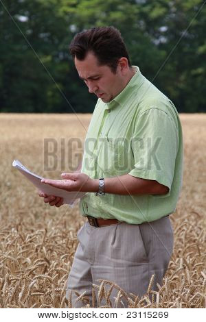 Agronomist On A Wheat Field