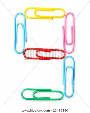 Colorful number nine from paperclips. One part of funny school or office alphabet.