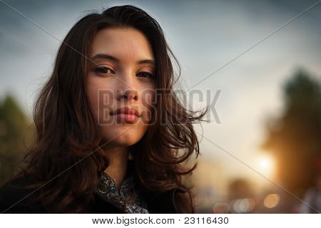 Portrait of beautiful Asian woman in city, closeup on face.