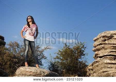 Young Girl In Shirt And Jeans