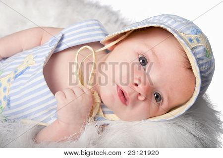 Curious Baby Boy In Hat Stares Ahead
