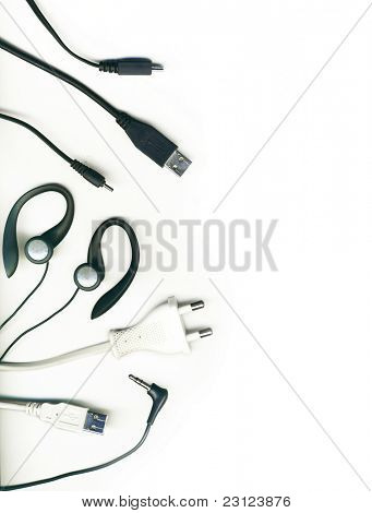 A collection of different electronic cables on a white background, isolated