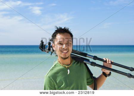 Portrait Of A Photographer On The Beach