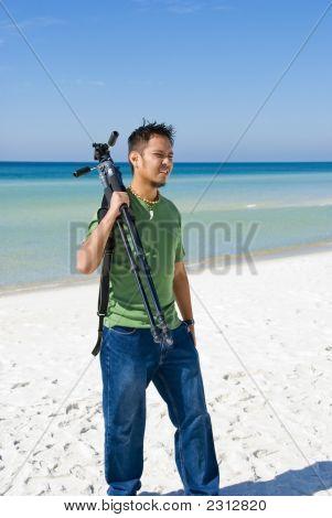 Man Holding Tripod On Location