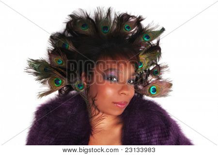 Beautiful African American woman with Peacock feathers in her hair