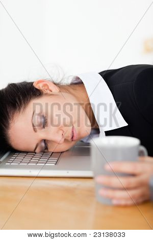 Sleeping Businesswoman With Her Head On Laptop