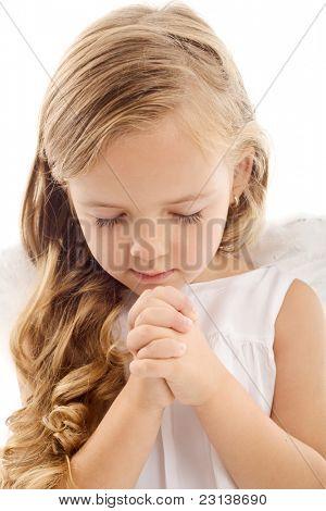 Beautiful little girl praying - closeup, isolated