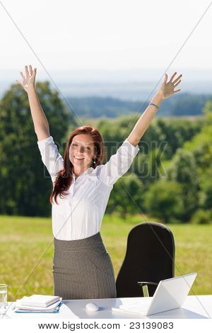 Businesswoman In Sunny Nature Office Hands Up