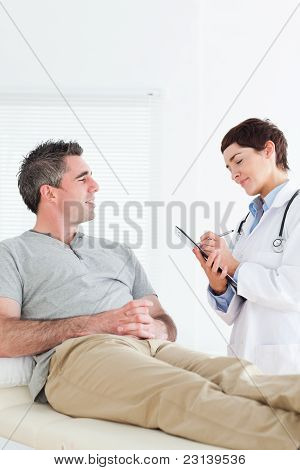 Female Doctor Talking To A Male Patient