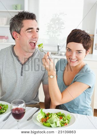 Cute Woman Feeding Her Boyfriend
