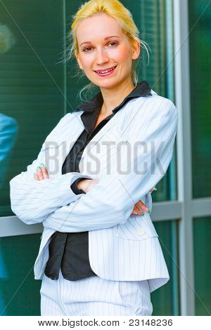 Smiling Business Woman Standing Near Office Building