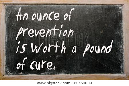 """an Ounce Of Prevention Is Worth A Pound Of Cure"" Written On A Blackboard"