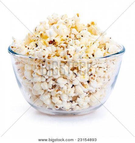 Big glass bowl of freshly popped popcorn isolated on white background