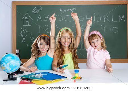 smart group of student kids at school classroom raising hand
